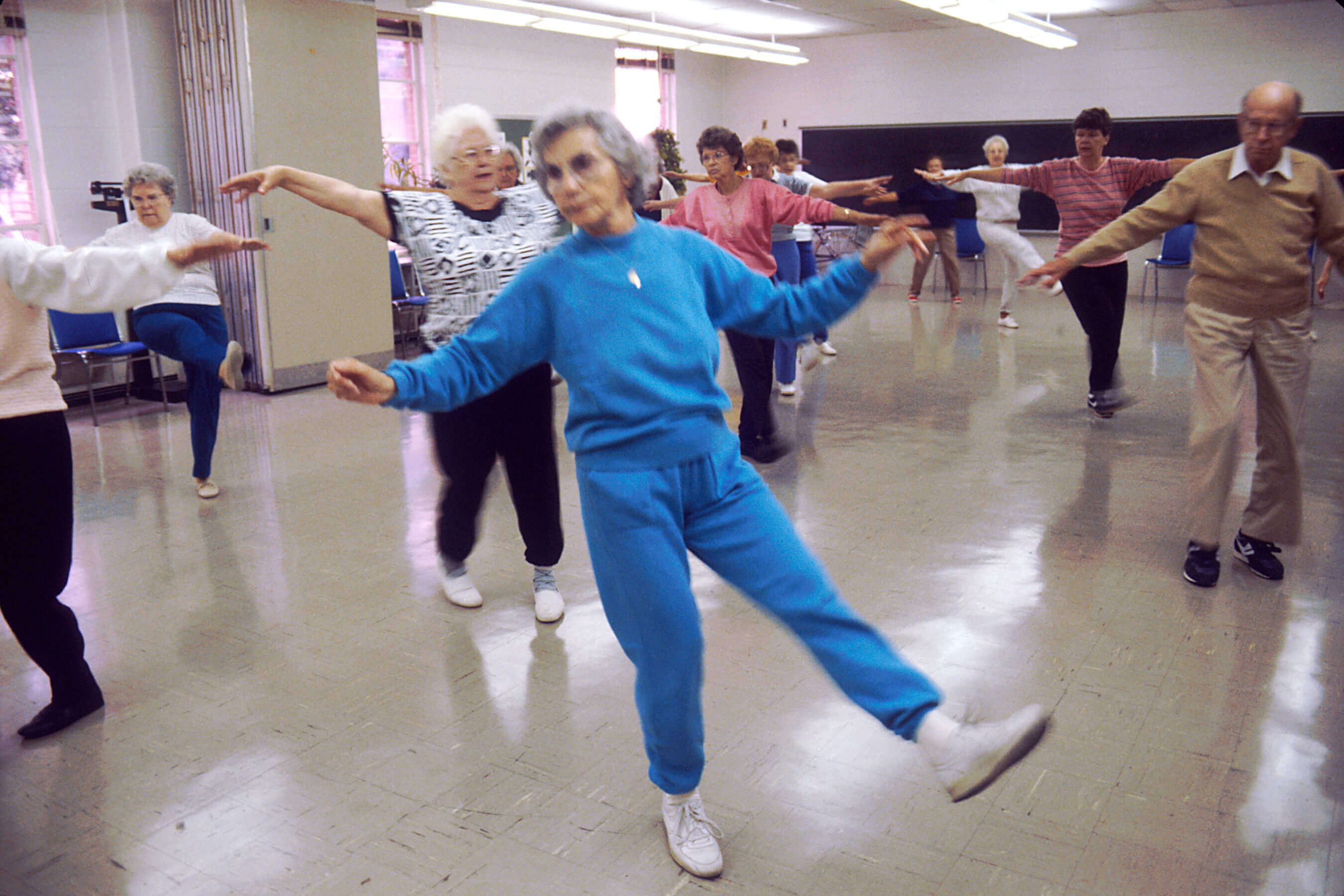 Elderly people exercising to music