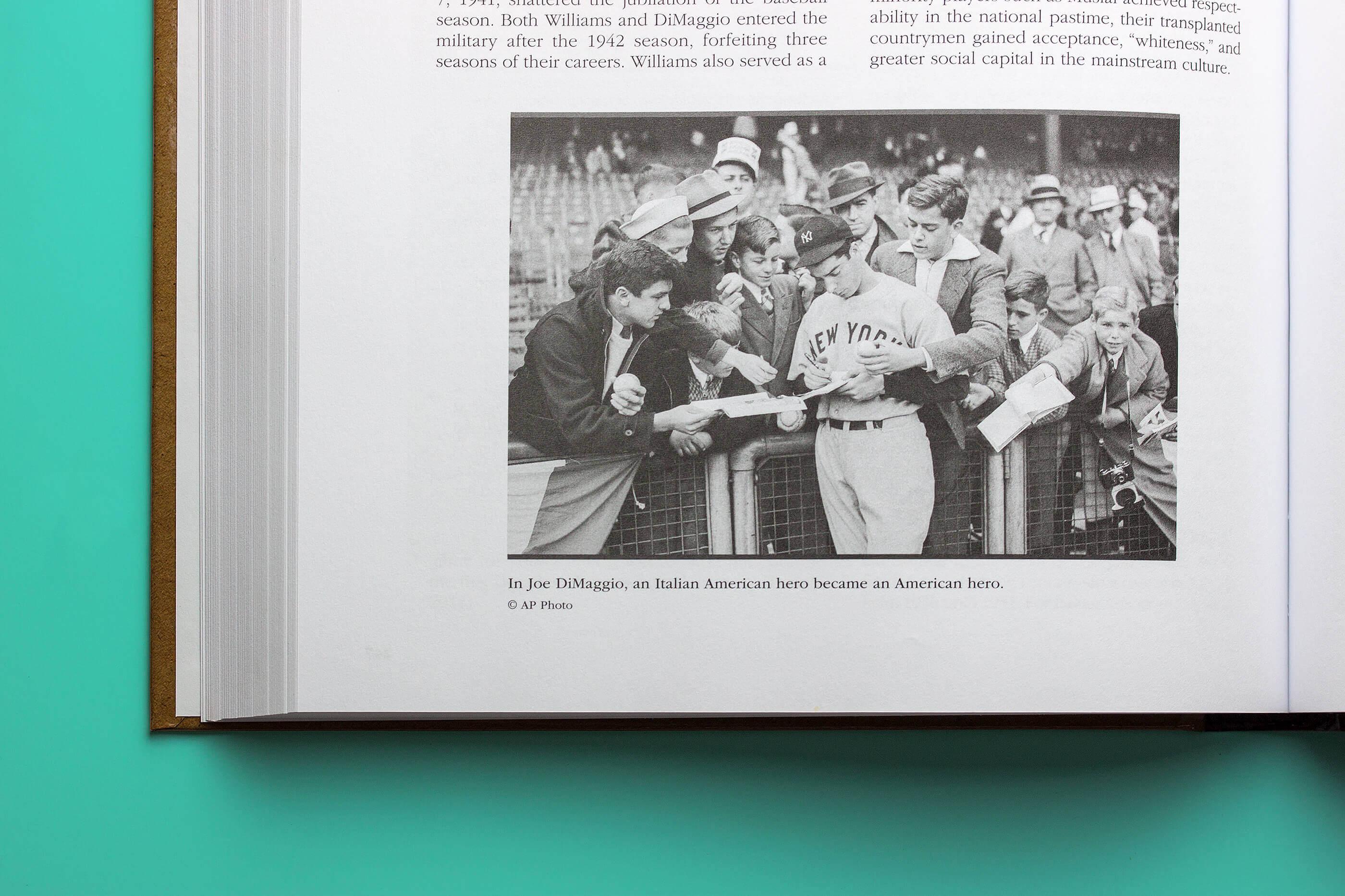 American baseball hero Joe DiMaggio signs autographs