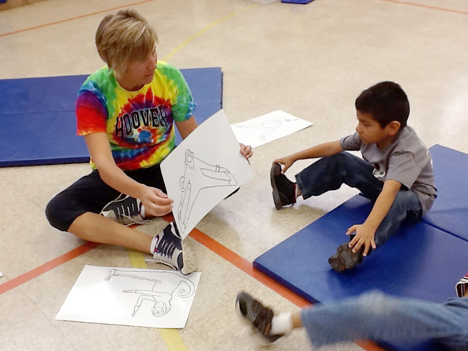 PE teacher playing a game with autistic child