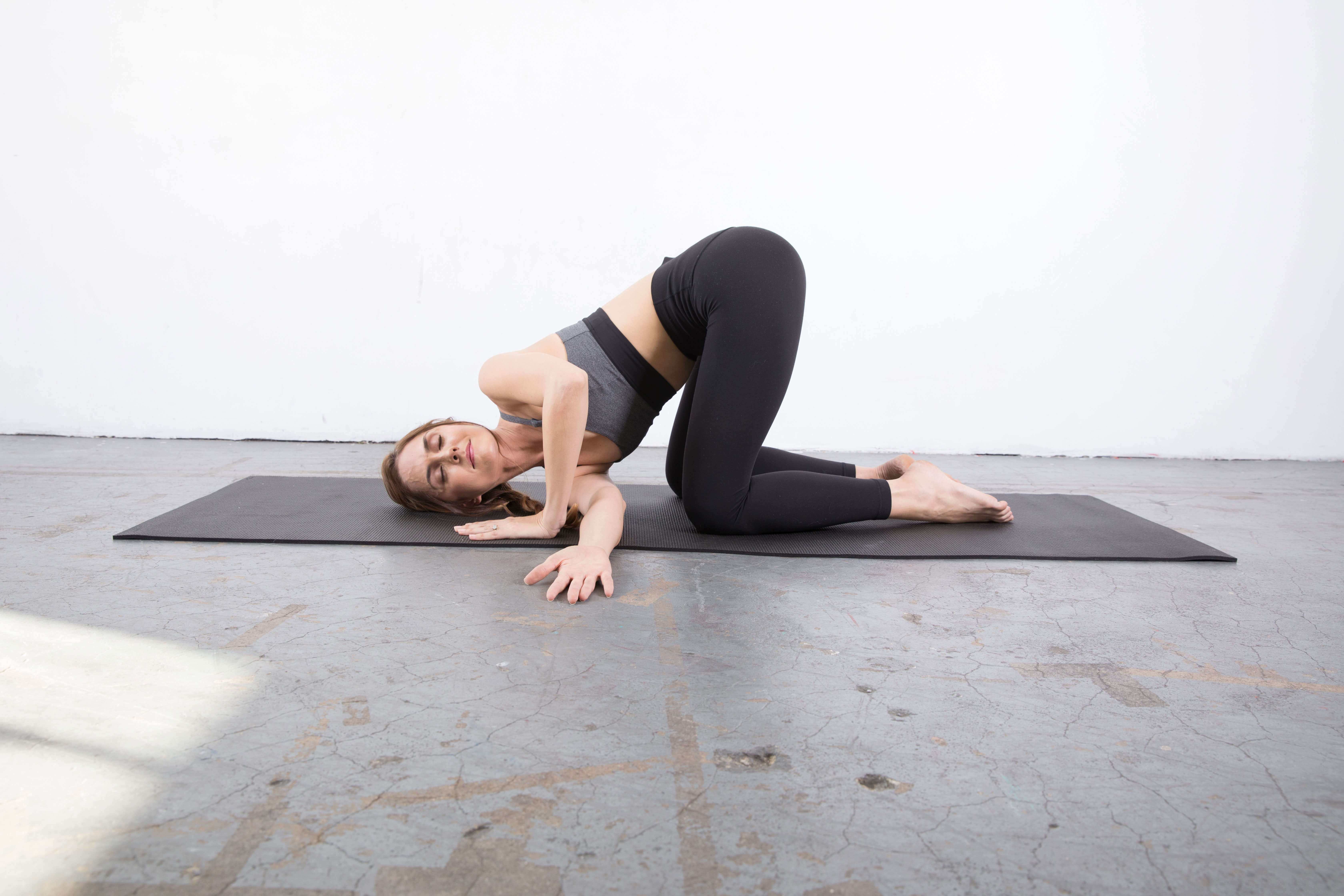 Thread the Needle Shoulder Stretch: Yin yoga poses for the shoulders