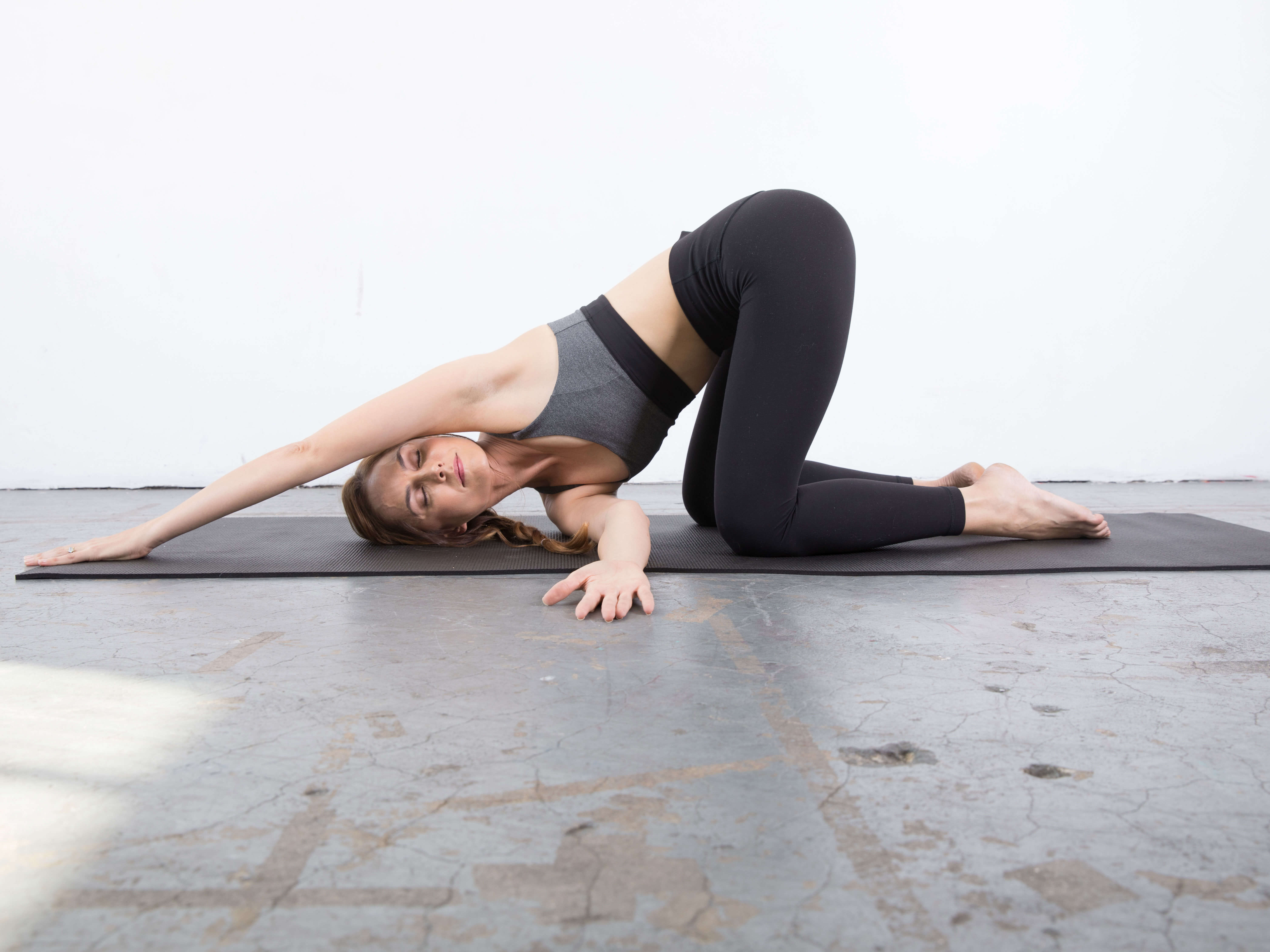 First modification for the Thread the Needle Shoulder Stretch : yin yoga poses for the shoulder