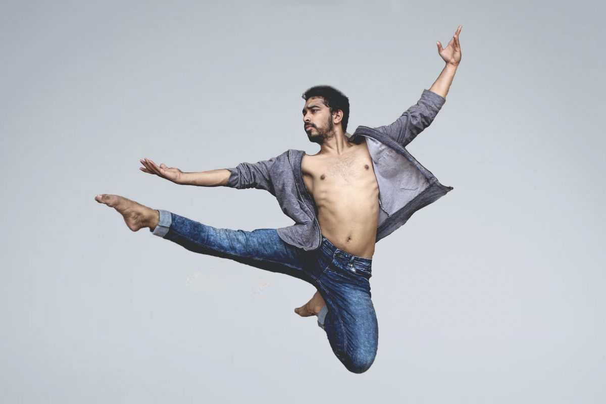 male dancer leaping into the are